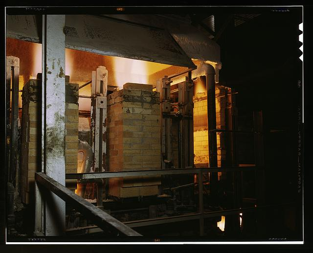 Owens-Corning Fiberglas Corporation, Toledo, Ohio. Side view of a glass furnace melting the carefully compounded batch required for the production of Fiberglas thermal insulation being installed in the hulls of naval vessels now under construction