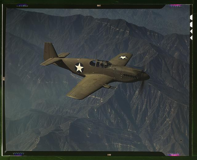 "P-51 ""Mustang"" fighter in flight, Inglewood, Calif. The ""Mustang"", built by North American Aviation, Incorporated, is the only American-built fighter used by the Royal Air Force of Great Britain"