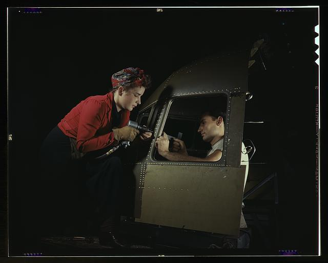 "Men and women make efficient operating teams on riveting and other jobs at the Douglas Aircraft plant, Long Beach, Calif. Most important of the many types of aircraft made at this plant are the B-17F (""Flying Fortress"") heavy bomber, the A-20 (""Havoc"") assault bomber and the C-47 heavy transport plane for the carrying of troops and cargo"