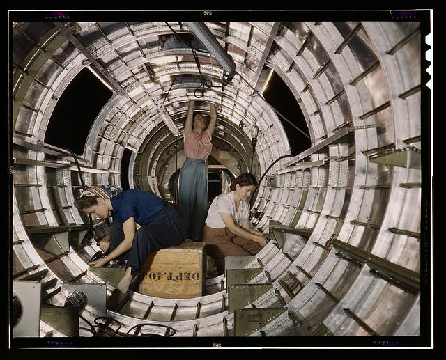 Women workers install fixtures and assemblies to a tail fuselage section of a B-17F bomber at the Douglas Aircraft Company, Long Beach, Calif. Better known as the &quot;Flying Fortress,&quot; the B-17F is a later model of the B-17 which distinguished itself in action in the South Pacific, over Germany and elsewhere. It is a long range, high altitude heavy bomber, with a crew of seven to nine men, and with armament sufficient to defend itself on daylight missions