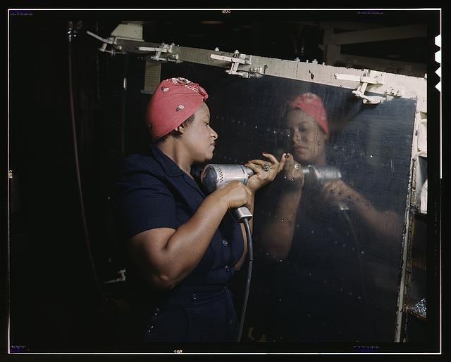 "Operating a hand drill at Vultee-Nashville, woman is working on a ""Vengeance"" dive bomber, Tennessee"