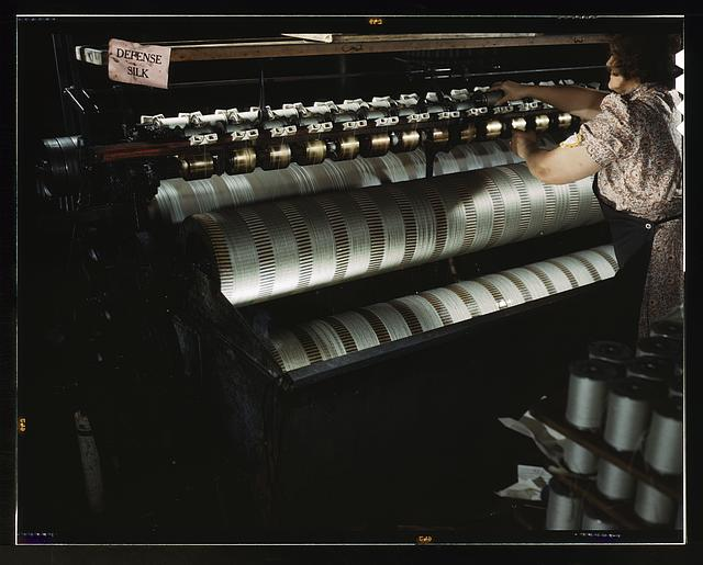 The water stretching machine of an eastern parachute manufacturer stretches shroud lines so as to make them more adaptable to the finished product, Manchester, Conn.