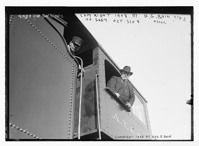 Taft in engine window of train