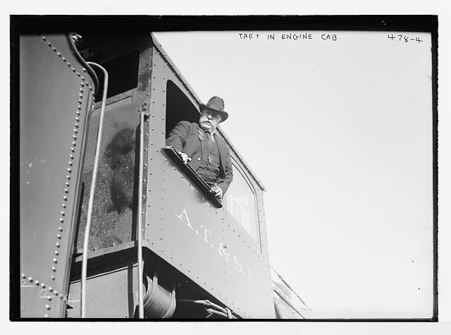 Taft in engine cab of train
