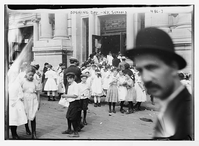 Children at school entrance, opening day, New York
