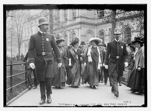 Suffragettes, preceded by policemen, leaving City Hall, New York