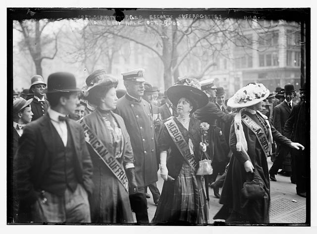 Capt. Schmittberger of police escorts suffragettes from City Hall, New York