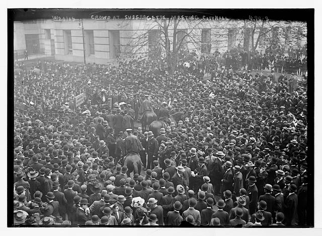Crowd gathered to hear suffragettes speak at City Hall, mounted policemen, New York