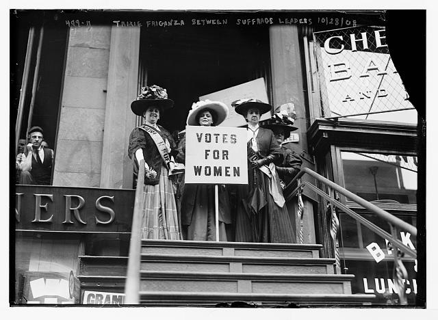 Trixie Friganza between other suffragettes on top of steps, New York