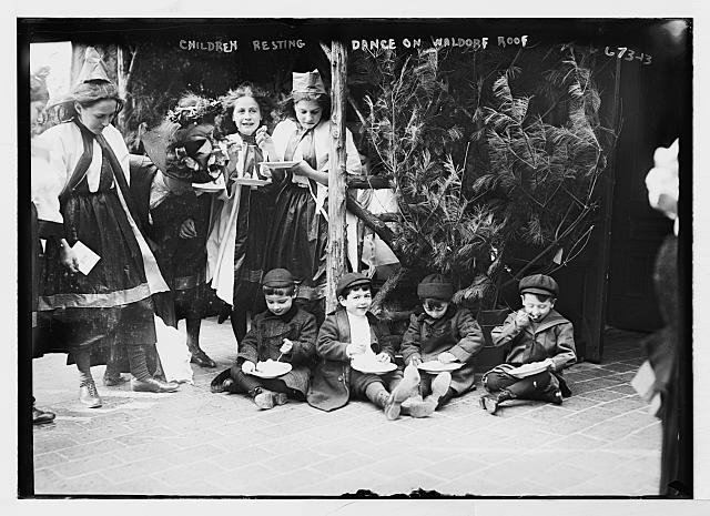 Children and dancers resting, eating, Waldorf roof, New York