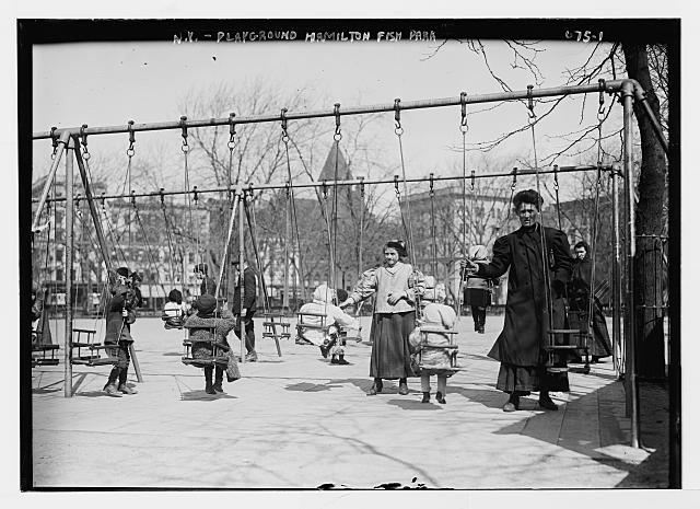 Children in swings, Hamilton Fish Park, New York