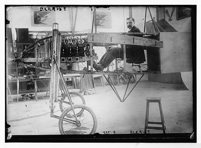 Bleriot, in workshop, in his flying machine