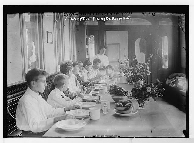 Consumptives dining on ferryboat, which is used as a tuberculosis camp