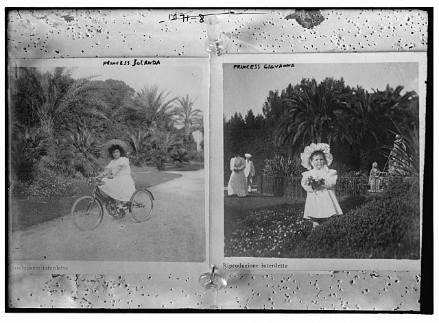 Princess Jolanda on bicycle; Princess Giovanna in garden holding flowers