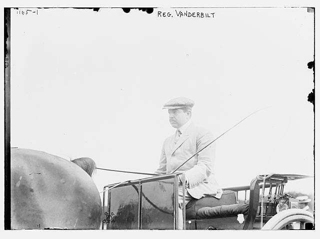 Reg. Vanderbilt in driver's seat of horse-drawn carriage