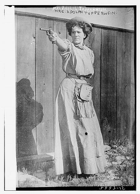 Mrs. Adolph Topperwein. [with gun]