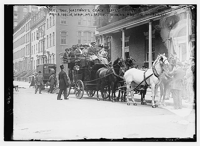 Mrs. Thos. Hastings's coach leaves Colony Club. 5/10/11. Mrs. A. Iselin, whip, Mrs. Hastings beside her, Mrs. W.G. Loew between