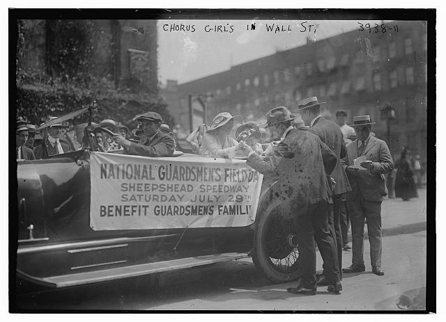 Chorus girls selling tickets [Wall St]
