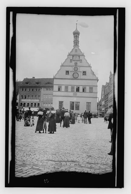 [Crowd watching post office clock. Rothenburg]