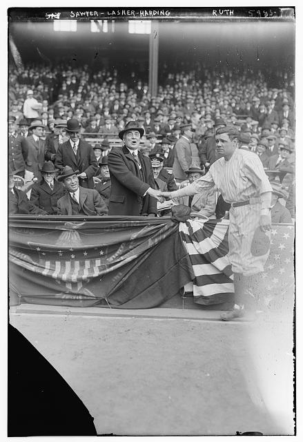 [Babe Ruth Shaking Hands With Pres. Warren Harding, at Yankee Stadium 4/24/23; Dr Chas. Sawyer (President's physician) & Albert Lasker also in box (baseball)]