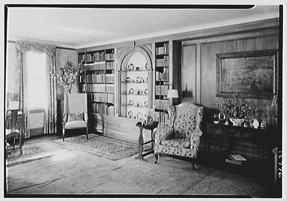 H.I. Nicholas, residence in E. Norwich, Long Island. China cupboard and books in living room