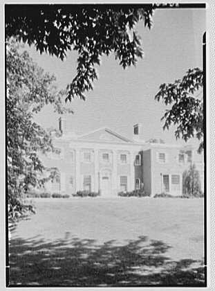 Roy D. Chapin, residence at 447 Lake Shore, Grosse Pointe Farms, Michigan. Entrance facade, vertical through tree