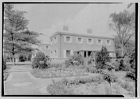 Roy D. Chapin, residence at 447 Lake Shore, Grosse Pointe Farms, Michigan. South facade over rose garden