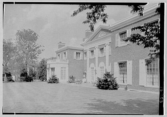 Roy D. Chapin, residence at 447 Lake Shore, Grosse Pointe Farms, Michigan. West facade, sharp view under tree