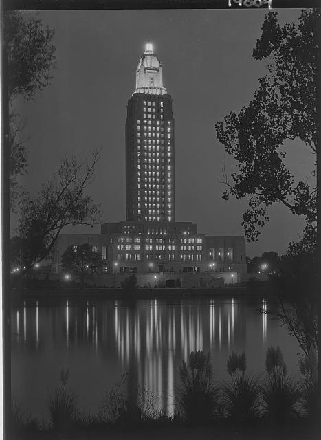 Louisiana State capitol, Baton Rouge, Louisiana. Tower lights at night, reflected in lake