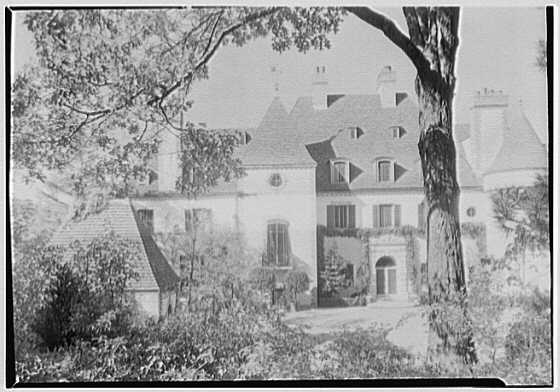 Mrs. Pierre Lorillard, residence in Tuxedo Park, New York. Entrance facade through trees, horizontal
