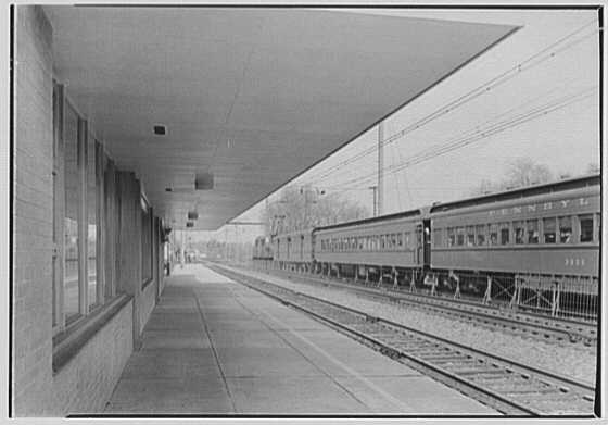 Aberdeen Station, Pennsylvania Railroad, Aberdeen, Maryland. Southbound station, overhang and train