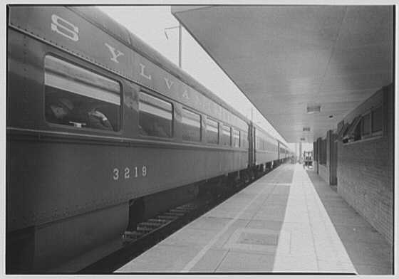 Aberdeen Station, Pennsylvania Railroad, Aberdeen, Maryland. Southbound station, platform and overhang, train on track