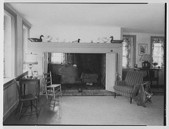 Mr. and Mrs. Eldredge Snyder, Carding Mill Farm, residence in Kellers Church, Pennsylvania. Living room fireplace, from door