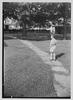 W.A. Burpee, residence in Doylestown, Pennsylvania. Stepping stones, with boy