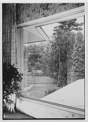 Model house, Orange, New Jersey. View through picture window to sign