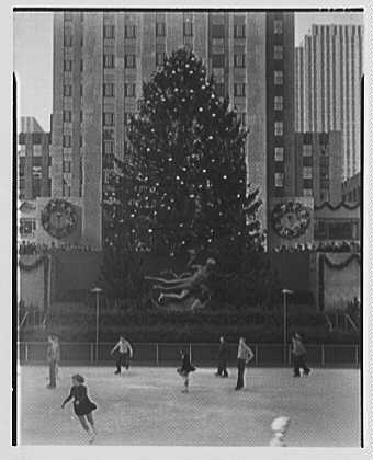 Rockefeller Center. Christmas tree and skaters, from left