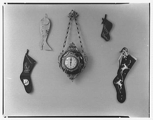 Mrs. Esther Wheeler, book photos at 1506 Woodside Ave., Baldwin, Long Island. Stockings and clock