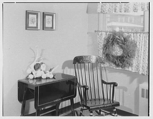 Mrs. Esther Wheeler, book photos at 1506 Woodside Ave., Baldwin, Long Island. Wreath and table arrangement
