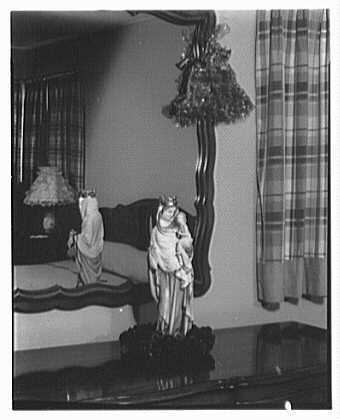 Mrs. Esther Wheeler, book photos at 1506 Woodside Ave., Baldwin, Long Island. Madonna in bedroom
