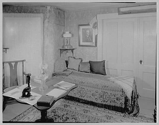 President Calvin Coolidge. To sofa in living room, showing the notary seal which his father used to swear him in as president