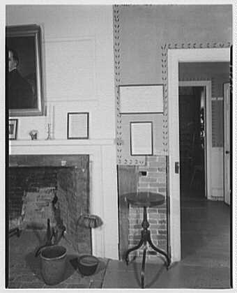 Pierce homestead, Hillsboro, New Hampshire. Wall showing restored stenciling and small (original) table