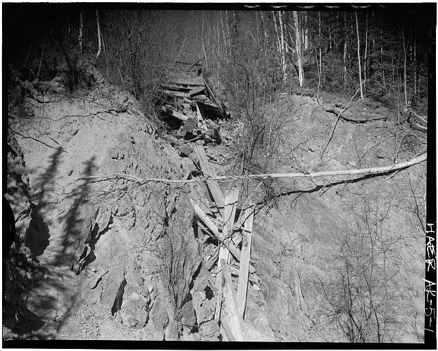 1.  PHOTOGRAPH TAKEN FROM THE SOUTH LOOKING NORTH ACROSS AN ERODED AREA. THE SOUTH END OF THE FLUME HAS COLLAPSED. - Davidson Ditch Waste Water Weir, Mile 63 of Alaska's Steese Highway, Chatanika, Fairbanks North Star Borough, AK