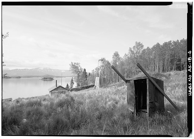 4.  WOODSHED, CABIN, WIND GENERATOR, OUTHOUSE, LOOKING SOUTHEAST - Roy Fure's Trapping Cabin, King Salmon, Bristol Bay Borough, AK