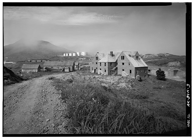 3.  APARTMENT BUILDING, POWERHOUSE, AND CHIEF'S HOUSE, LOOKING NORTHEAST - Naval Operating Base Dutch Harbor & Fort Mears, Naval Radio Station Apartment Building, Unalaska, Aleutian Islands, AK
