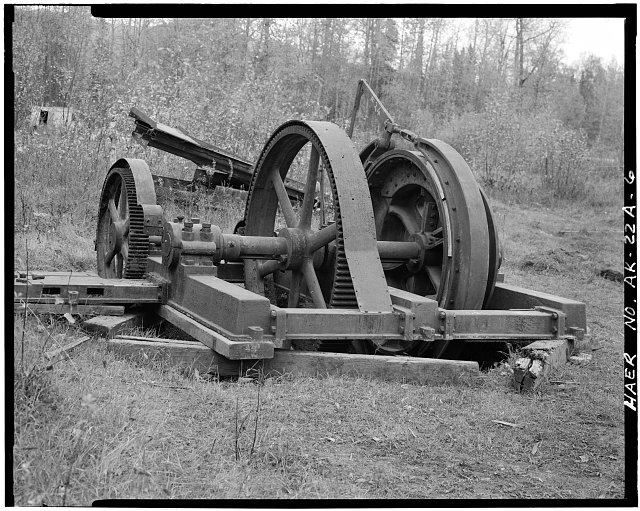 6.  OBLIQUE VIEW OF HOIST, SHOWING WOODEN BRAKE SHOES, REDUCTION GEARS AND BED FOR (MISSING) CLUTCH/DRIVE GEAR UNIT, LOOKING NORTHWEST - Buffalo Coal Mine, Vulcan Cable Hoist, Wishbone Hill, Southeast end, near Moose Creek, Sutton, Matanuska-Susitna Borough, AK