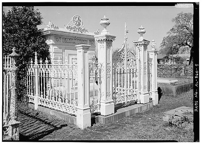 4.  OBLIQUE VIEW OF FRONT OF TOMB AND FENCE WITH ORNATE GATE POSTS - Slatter Family Tomb, Magnolia Cemetery, Virginia Street, Mobile, Mobile County, AL