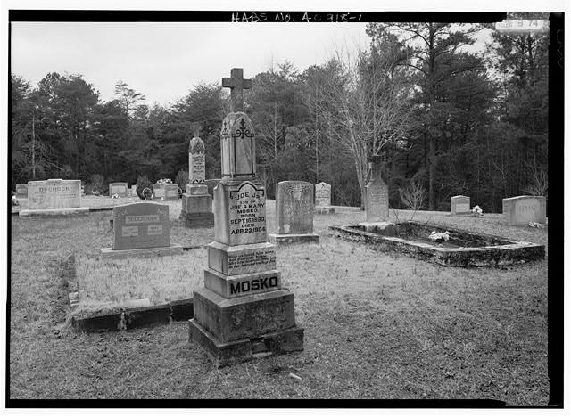 1.  OVERVIEW, LOOKING WEST, TOMBSTONES, STATUES AND GRAVE PLOTS OF THE DUCHOCK, MOSKO, BENKO AND OTHER FAMILIES OF THIS FORMER COAL MINING AREA SETTLED BY CZECH AND SLAVIC MINERS IN THE 1880S AND 1890S - St. Michael's Cemetery, Brookside Road, Brookside, Jefferson County, AL