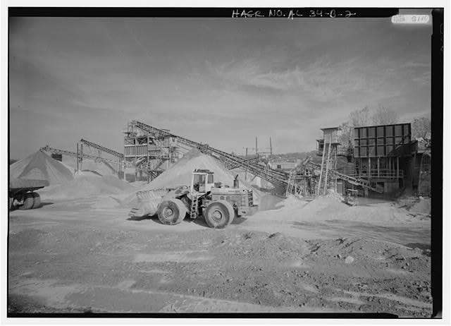 EXTERIOR VIEW, LOOKING EAST, OF REDUCTION PLANT NO. 6 WITH PRIMARY AND SECONDARY LIMESTONE REDUCTION ('CRUSHING') IN PROGRESS AND A FRONT END LOADER (CONFIRM NAME OF VEHICLE?). - Wade Sand & Gravel Company, Reduction Plant No. 6, State Route 78, Thomas, Jefferson County, AL