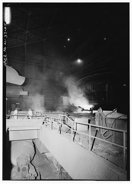 CAST FLOOR WITH VIEW OF TORPEDO LADLE (BENEATH CAST FLOOR) AND KEEPERS OF THE CAST HOUSE FLOOR, S.L. KIMBROUGH AND DAVID HOLMES. - U.S. Steel, Fairfield Works, Blast Furnace No. 8, North of Valley Road, West of Ensley-Pleasant Grove Road, Fairfield, Jefferson County, AL