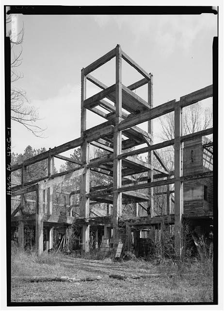 EXTERIOR VIEW, LOOKING NORTHEAST, WITH CONCRETE-CLAD STRUCTURAL FRAME. - Shelby Iron Works, Structural Framing, Chemical Plant No. 1, County Road 42, Shelby, Shelby County, AL